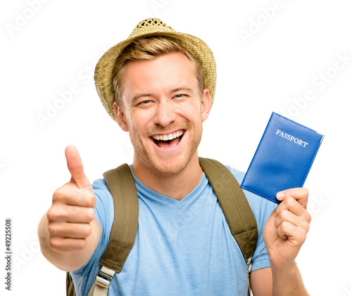Happy young tourist man holding passport thumbs up white backgro