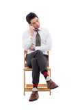 Thinking businessman sitting on the chair.