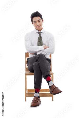 Young Asian business man sitting on the chair.