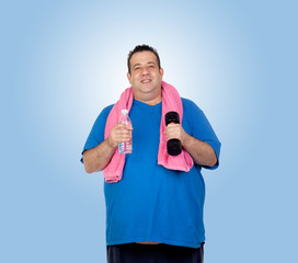 Fat man in the gym with a water bottle