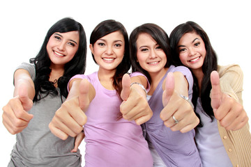 Group of beautiful women with thumbs up