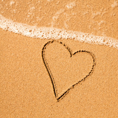 Shape of the heart of the sea on the beach in Valentine Day.