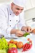 male chef doing garnish