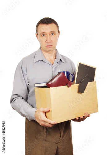 Dismissed man with cardboard box