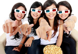 woman pointing to TV while watching 3d movie