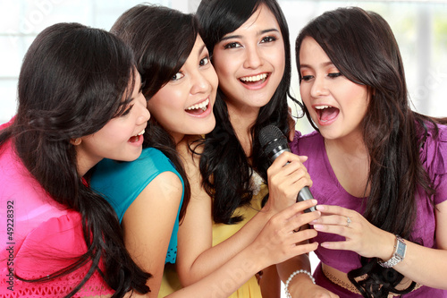 woman singing karaoke together