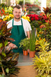 Young man scanning barcode flower shop gardening