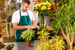 Man florist reading price barcode reader flower