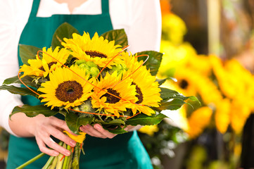 Bouquet sunflowers flower shop female florist holding