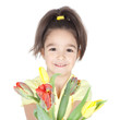 Beautiful little girl with a bouquet of tulips on white