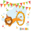 Circus lion jumping through a ring of fire.