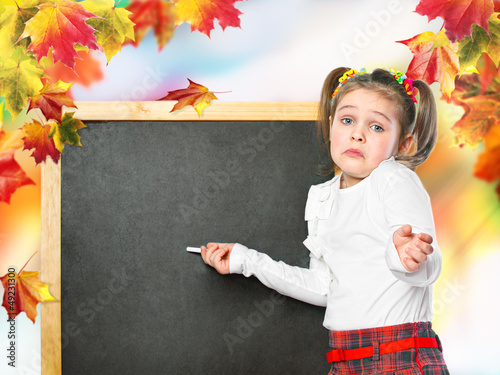 schoolgirl wrote in chalk on the chalk board, on an abstract bac