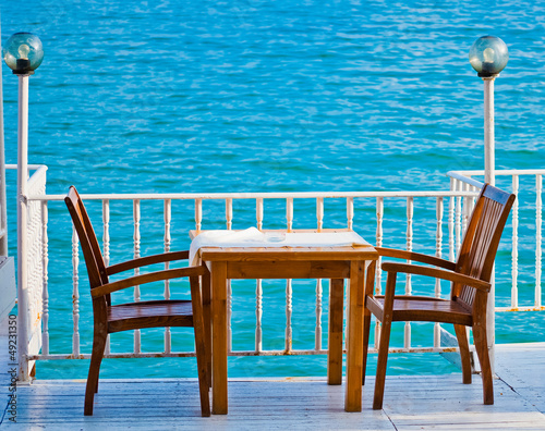 Table in a restaurant with sea view