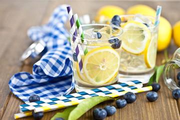 Homemade lemonade with lemons and blueberries