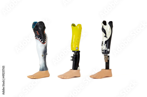 Three prosthetic legs.