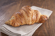 Butter croissant on rustic table