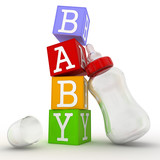Baby concept of cubes with feeding bottle