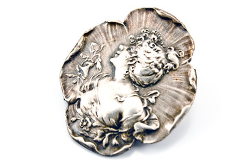 Antique silver brooch with woman's profile