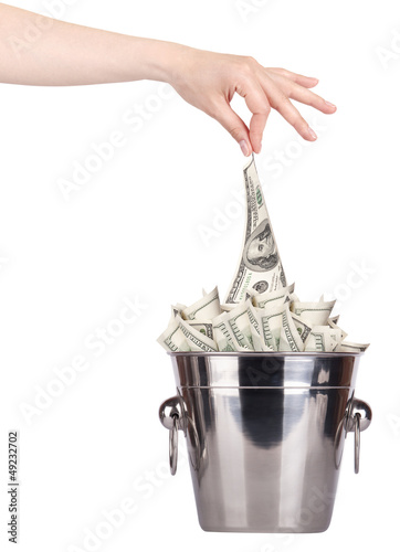 Bucket with money and hand