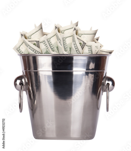 Bucket with money on white background