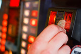 Inserting pound sterling coin into Gaming machine