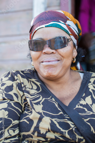 African woman with sunglasses.