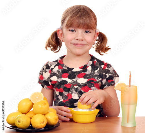happy little girl make lemonade