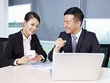 asian business people talking in office