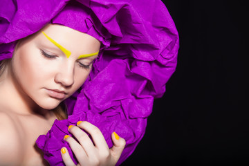 Creative fashion hair and makeup of young model. Close up