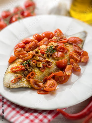 sole fish with tomato anchovy and hot chili pepper, selective fo