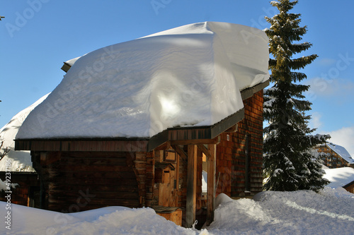 Wooden cottage in the winter mountains. France.