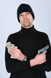 man in black outfit with money and gun