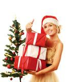 Beautiful girl in santa hat with gift and showing ok
