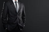 Close up of businessman over dark gray background