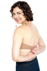 Passionate hot woman adjusting her bra