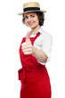 Young baker woman gesturing thumbs up