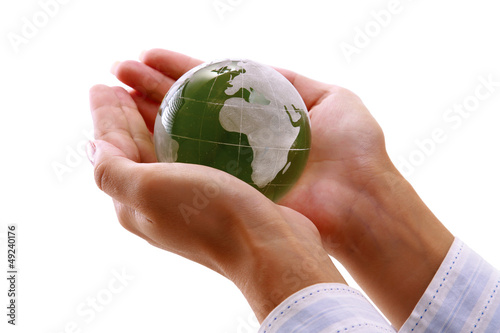 Female hands holding glass earth , isolated on white background