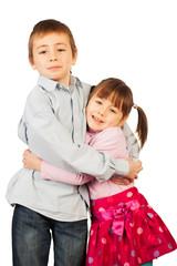 Young siblings hugging