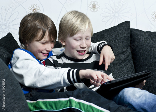 Kids having fun with a tablet