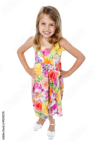 Aerial shot of trendy young girl in sleeveless frock