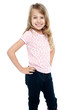 Cheerful girl child with hands on waist
