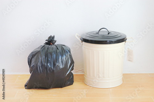 a black plastic bag and reuse disposal bin
