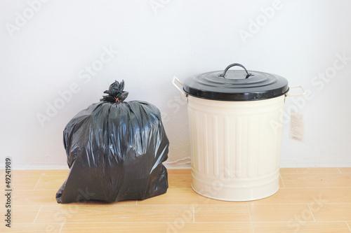 a black plastic bag and reuse disposal bin