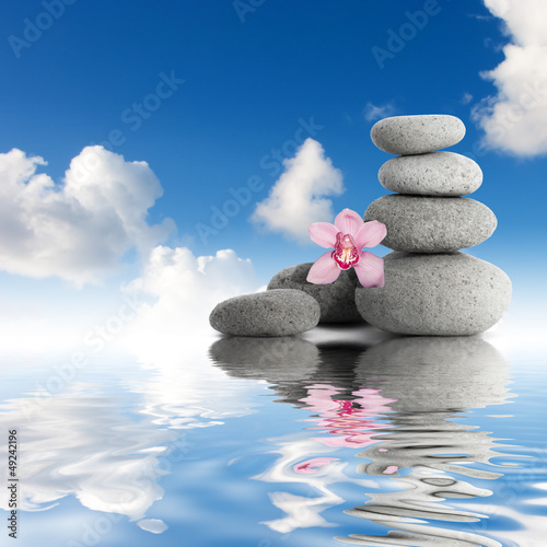 Gray zen stones and orchid sky with clouds