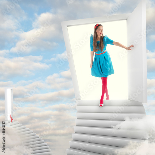 Girl walking through a magic door in sky
