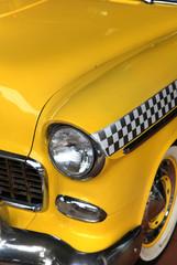 Yellow classic car taxi close up shot