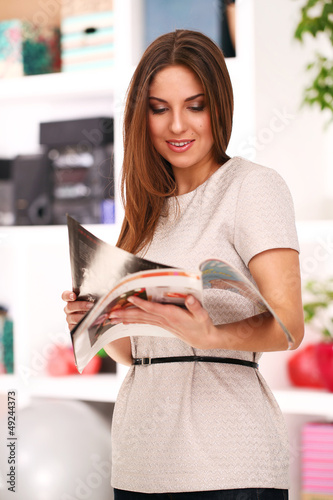 Young caucasian woman with journals