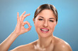 Caucasian natural woman with ok sign