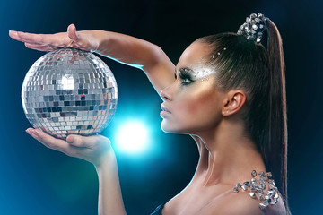 Woman with artistic make-up and discoball