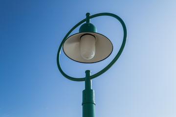 A green street lamp